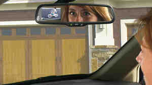 Gentex Corp.'s rearview mirror camera display enables drivers to see objects and people behind the vehicle using a tiny camera mounted to the back of the car.