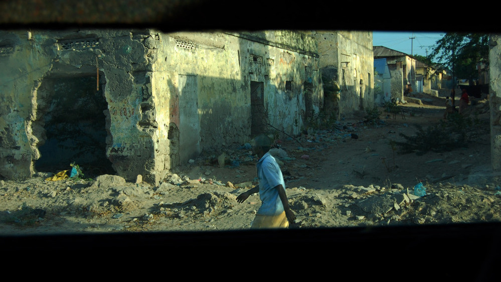 A Mogadishu street scene as viewed from an African Union  armored personnel carrier. The vehicles are paid for by the United  States.