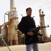 A rebel militiaman stands guard at a Libyan oil refinery Sunday in Al Brega, Libya. The opposition leadership has stressed that oil facilities in rebel-held territory are safe, despite the conflict roiling the country.
