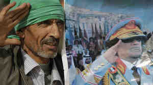 A Gadhafi supporter simulates the salute portrayed in a photograph of Libyan Leader Moammar Gadhafi, as he and others stage a small rally on the stage of the Roman amphitheatre at the Sabratha archaeological site.