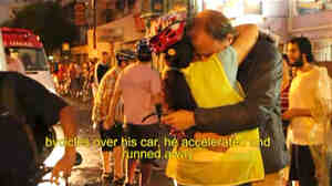 A screengrab from a YouTube video shows cyclists in Brazil comforting each other after a car plowed through a Critical Mass bike ride Friday.