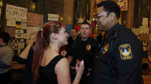 Wisconsin Capitol Police Chief Charles Tubbs, right, talks to a protester at the state Capitol on Sunday, Feb. 27, 2011, after it was announced the demonstrators will stay another night at the Capitol.