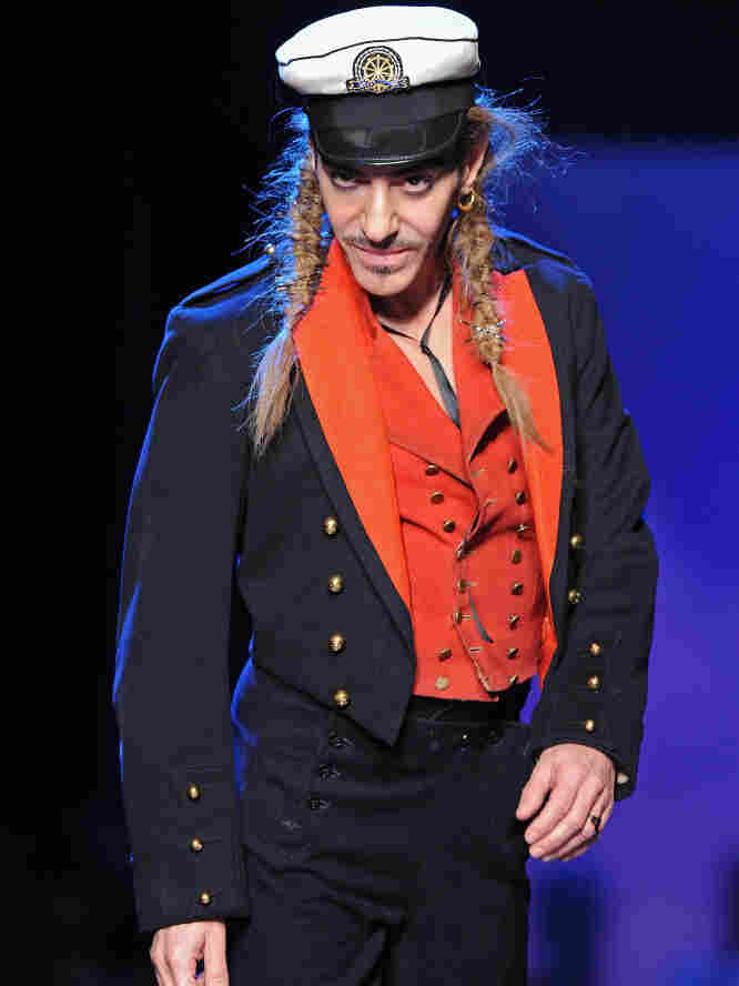Designer John Galliano walks the runway during a Christian Dior show in Paris, October 2010. Galliano was fired by the fashion label Tuesday over allegations of racism and anti-Semitism.
