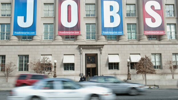 """A banner reading """"Jobs"""" hangs on the facade of the U.S. Chamber of Commerce in Washington, D.C., last month. Several economists are predicting massive job losses if the GOP succeeds in their push to cut billions in spending. Republicans, however, are pushing back against those claims."""