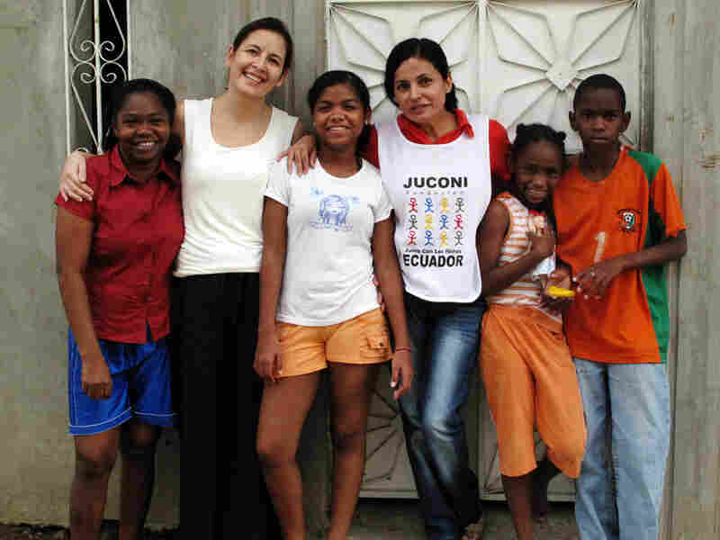 Sylvia Reyes (second from left), leader of Juconi in Guayaquil, with the Angulo family. She and Martha Espinoza (fourth from left) have worked with the family for more than  six years, helping with everything from nutrition to emotional health.
