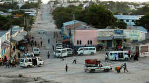 A view of Mogadishu's strategic junction, known as Kilometer 4. While the city is very dangerous, bullets don't fly all the time. When things  are calm, people are often out and about, shopping and chatting.
