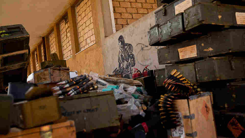 Ammunition and weapons are scattered around an arms depot in Ajdabiya, Libya, on Tuesday.