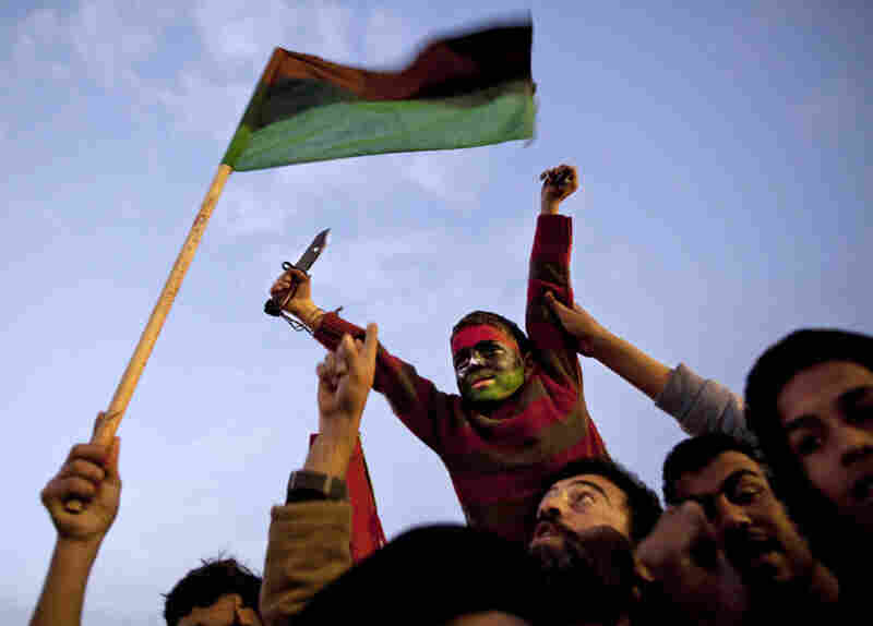 People in the eastern city of Tobruk chant slogans against Libyan leader Moammar Gadhafi during a weekend demonstration against the regime.