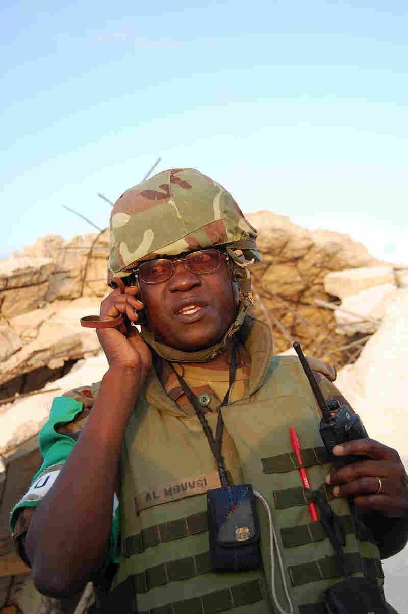 Maj. Anthony Lukwago  Mbuusi of the Ugandan army listens to reports from the night's attacks on his firing positions in Mogadishu.