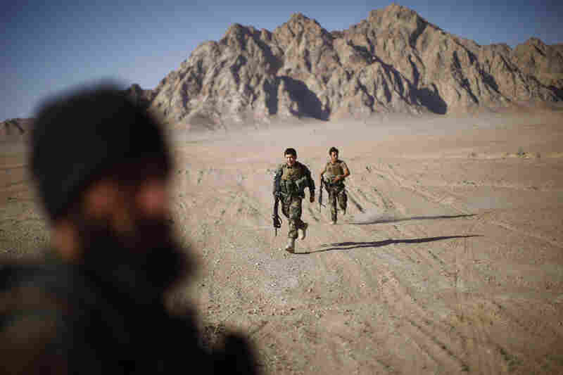 American and Afghan special forces, along with Afghan commandos, train together not far from their base in southern Afghanistan. The highly trained special forces and commandos spend more time firing their weapons than any other Afghan or American units.