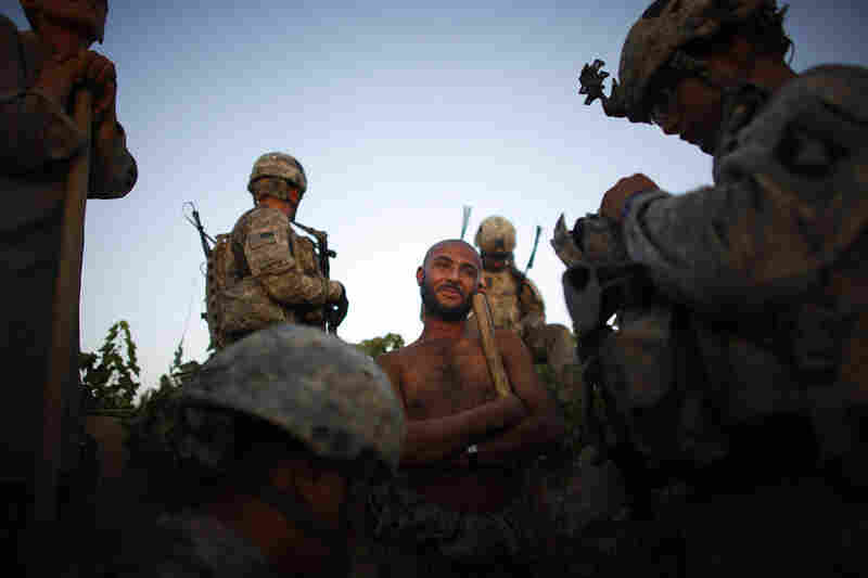 Soldiers with Bravo Company, 101st Airborne Division, and their Afghan counterparts interrogate an Afghan farmer after undergoing attacks from insurgents in the village of Pashmul in Kandahar province. One of the toughest problems is discerning friend from foe. Even the Afghan soldiers have a hard time identifying who the enemy is.
