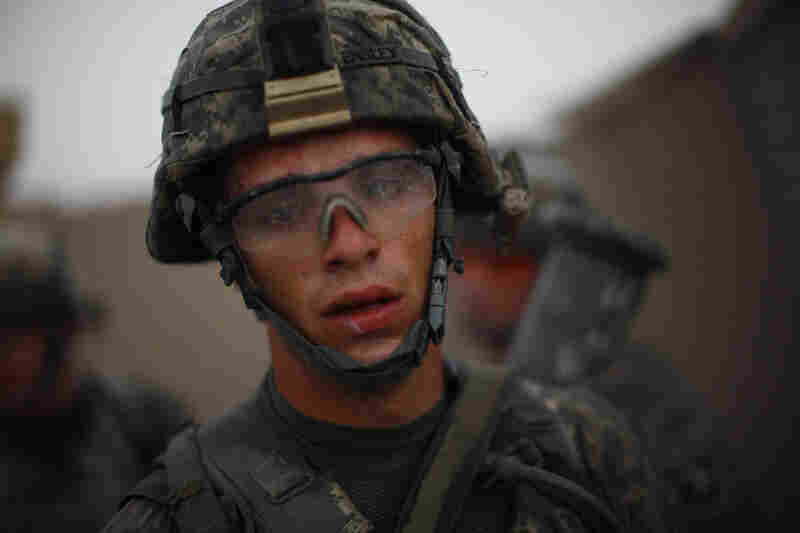 Pvt. Cody Lee Ensley of Bravo Company, 101st Airborne Division, arrives back at Forward Operating Base JFM. Ensley's company and its Afghan counterparts fought a running gun battle for hours in the searing summer heat of Zhari district, in southern Afghanistan.