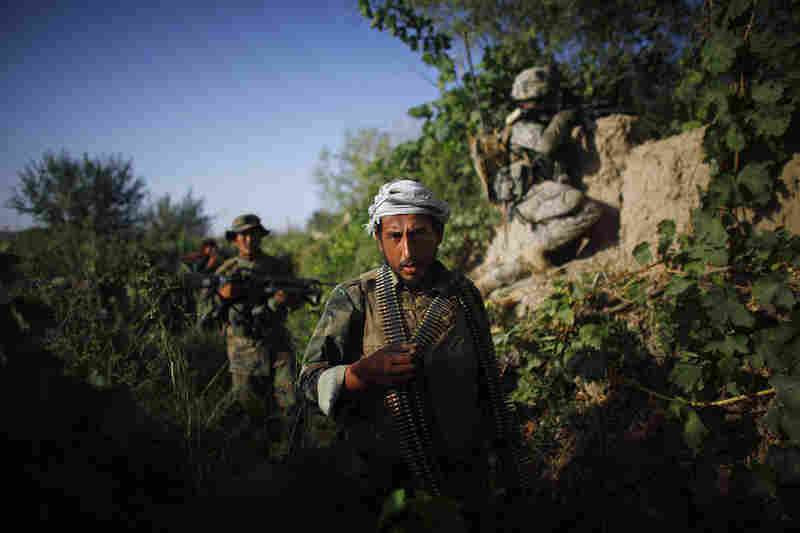 Afghan soldiers patrol with U.S. soldiers near the village of Payendi Pashmul in Kandahar province. Afghan soldiers are working shoulder-to-shoulder with American troops, training to take the lead in the defense against insurgents.