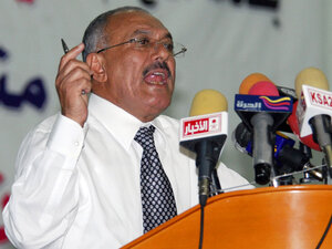 Yemeni President Ali Abdullah Saleh gives a speech at Sanaa University on Tuesday as vast numbers of protesters poured into a nearby square for a massive anti-regime rally.