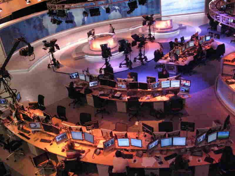 Staff members of Al-Jazeera prepare for a broadcast in Doha, Qatar.
