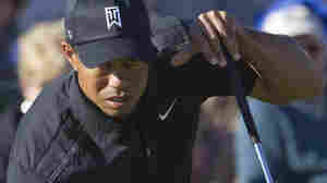 Tiger Woods lines up a putt on the 17th green during the first round of the Match Play Championship golf tournament on Feb. 23 in Marana, Ariz. His opponent, Thomas Bjorn, won in 19 holes, eliminating Woods.