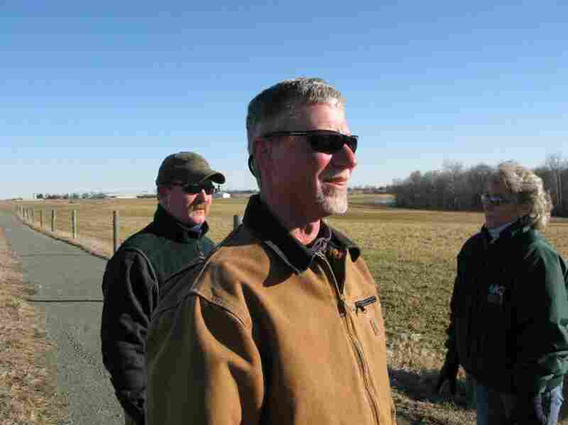 """We just make sure we're meeting the letter of the organic regulations to the T,"" says Tom Spohn (foreground), director of dairy operations for Horizon Organic. Behind him are farm manager Dudley McHenry and Sissy Everett."