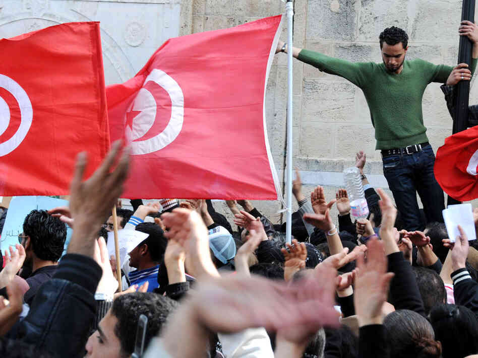 Thousands of people rally in Tunis on Feb. 20, demanding the government's resignation and a new constitution.