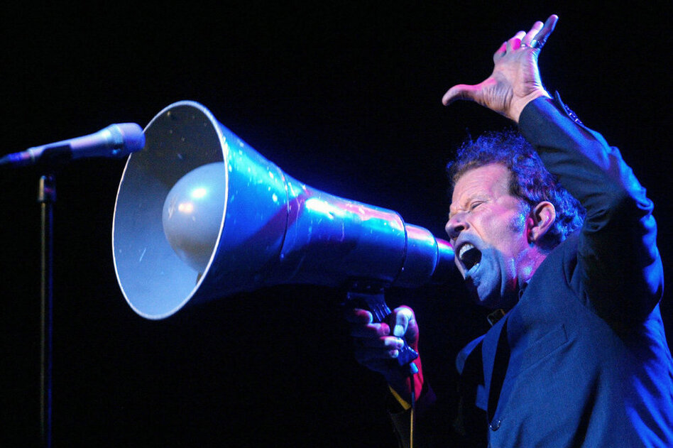 """As Waits says, """"Nothing beats the drama of a bullhorn."""" He often incorporates loud and enthralling elements into his live shows.  (Getty Images)"""