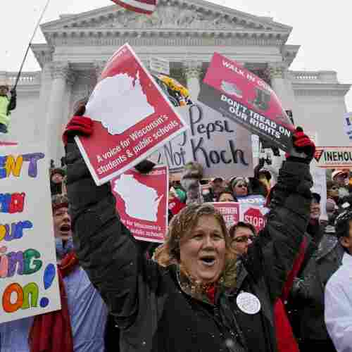 Teacher Kristen Henningfeld, center, of Elk Mound, Wis., protests on the  steps of the state Capitol in Madison, Wis., on Feb. 26.