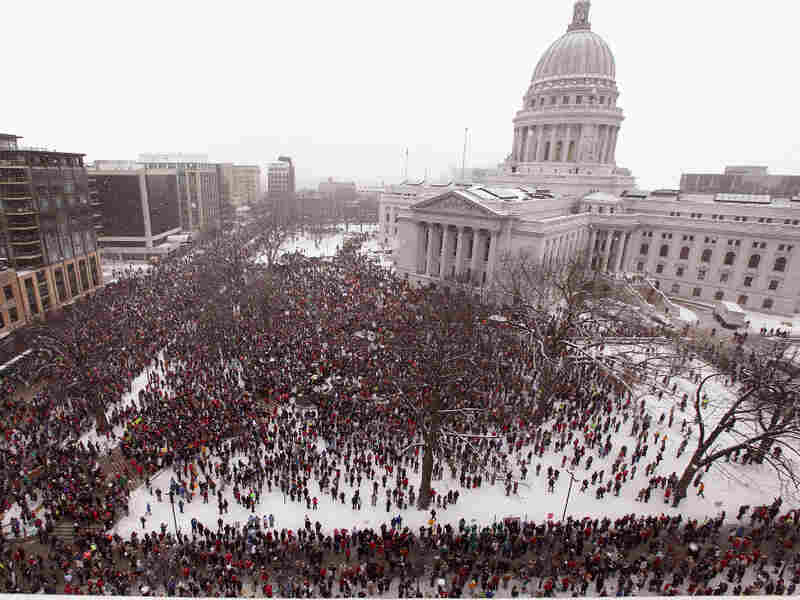 An estimated 70 to 100 thousand demonstrators rally outside the capitol building protesting the proposed budget repair bill in Wisconsin. Fourteen Democrat senators remain in hiding to avoid a quorum needed to vote on a budget repair bill.