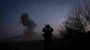 A U.S. soldier records video footage while blowing up an improvised explosive device found by an Afghan villager in Kandahar province on Dec. 29. The military is using new technology — sensors attached to American aircraft — to sniff out roadside bombs.