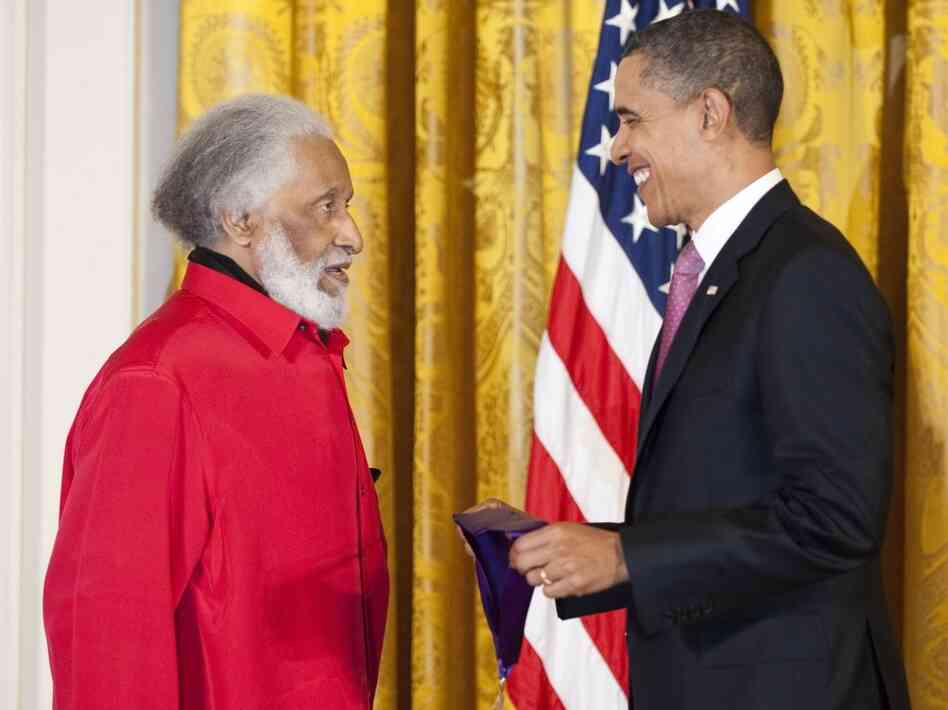 President Barack Obama presents Sonny Rollins with his National Medal of Arts.