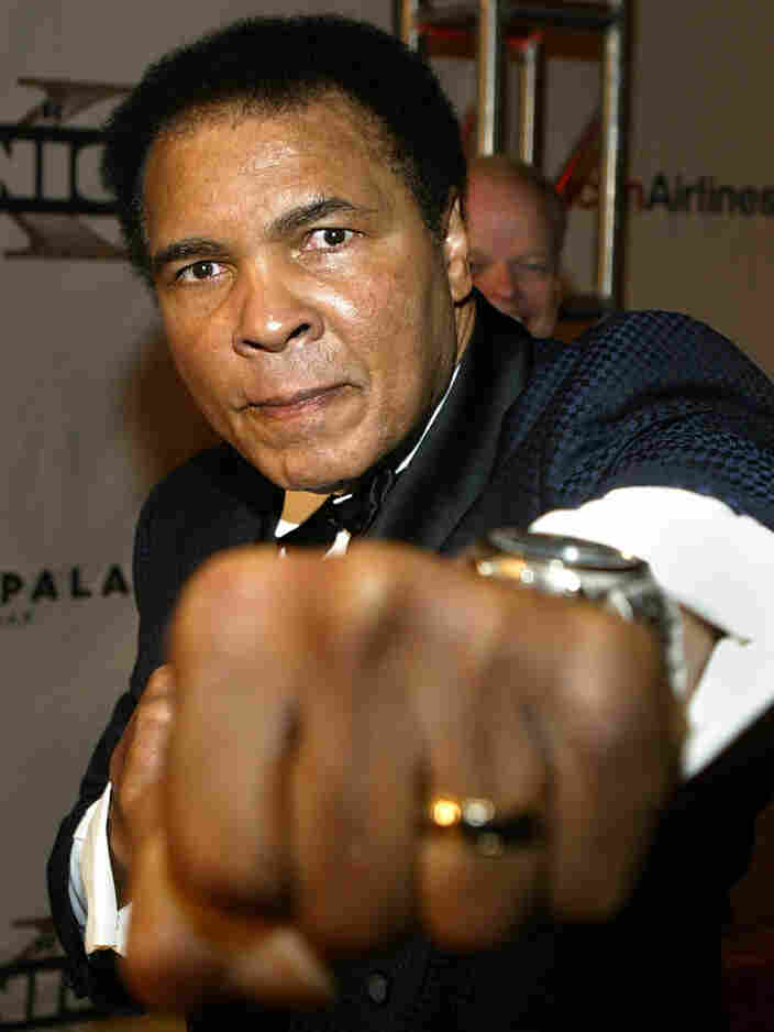 """Boxing legend Muhammad Ali arrives at """"Celebrity Fight Night X,"""" a charity event to raise money for the Muhammad Ali Parkinson Research Center at Barrow Neurological Institute in March 2004."""