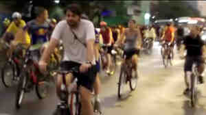 A video screengrab shows riders in the Critical Mass bike ride last Friday, seconds before a car sped through the Porto Alegre street.