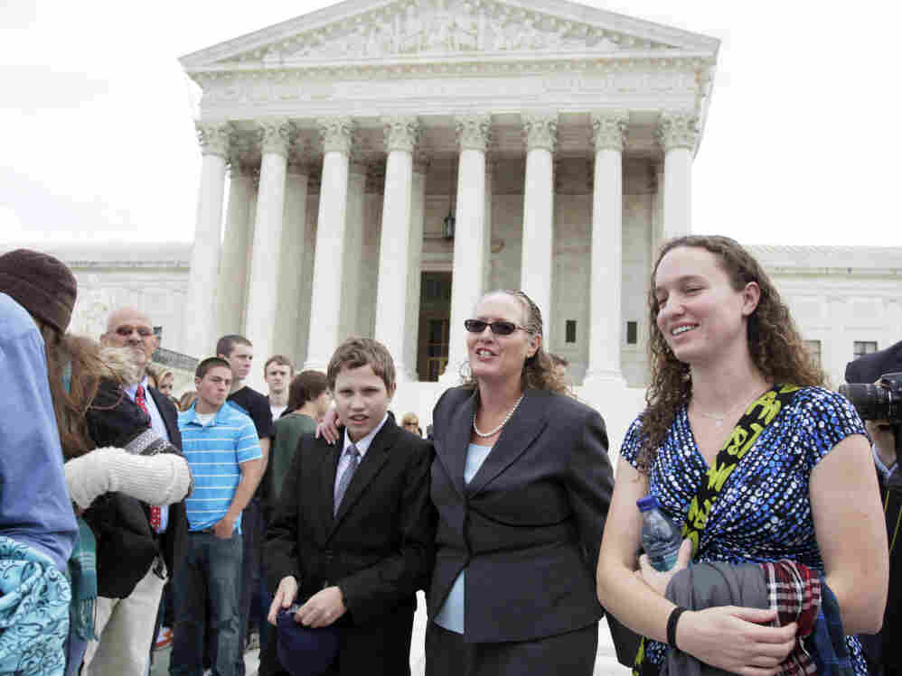Margie Phelps, second from right, a daughter of Fred Phelps, and the lawyer who argued the case for the Westboro Baptist Church, walks from the Supreme Court last October. The Supreme Court has ruled that the First Amendment protects the fundamentalist church's attention-getting, anti-gay protests outside military funerals.