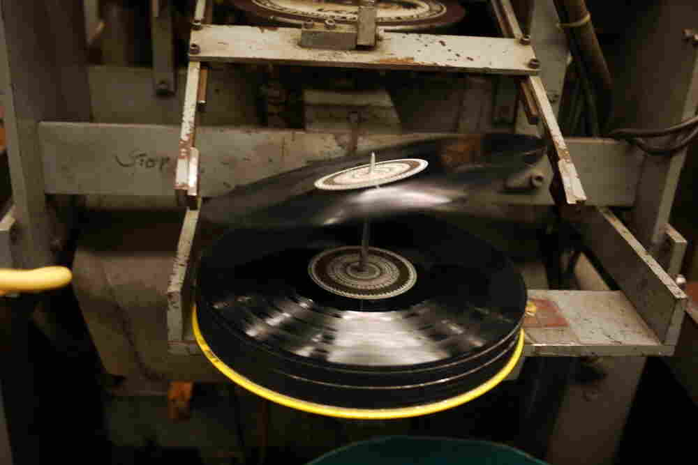 A 12-inch record tips onto the spindle at EKS Manufacturing.