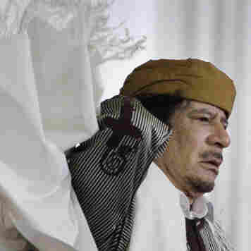 Libyan Leader Moammar Gadhafi adjusts his gown after speaking to supporters and the media in Tripoli on Wednesday.