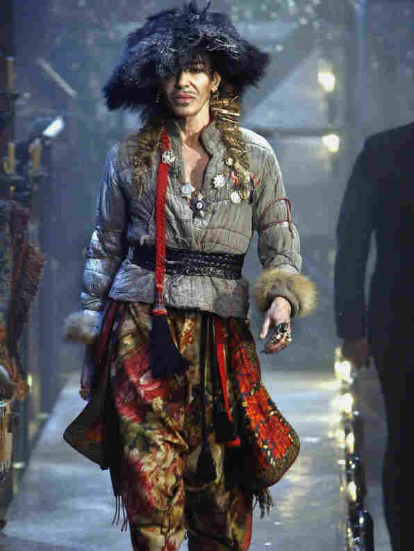 British fashion designer John Galliano, seen here on the runway during a show for his January fall-winter collection, has apologized for the behavior that led Christian Dior to fire him.