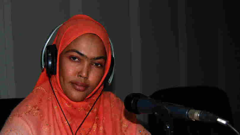 Sagal Siad reads the news on the government's Radio Mogadishu. Many of the  reporters at the U.S.-funded radio station have been targeted for assassination by  Islamic extremists.