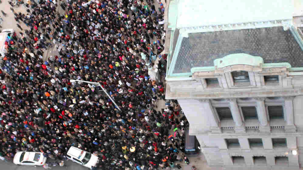 Teachers and union members rally on the steps of Providence, R.I., City Hall on Wednesday to protest the firing of the city's entire teaching force.