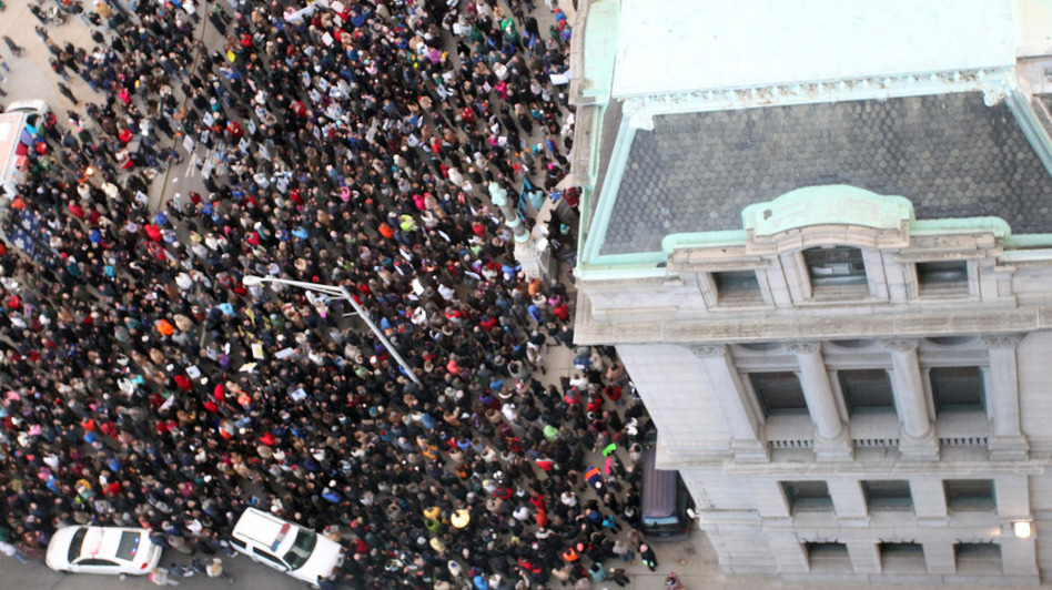 Teachers and union members rally on the steps of Providence, R.I., City Hall on Wednesday to protest the firing of the city's entire teaching force. (Stew Milne/AP)