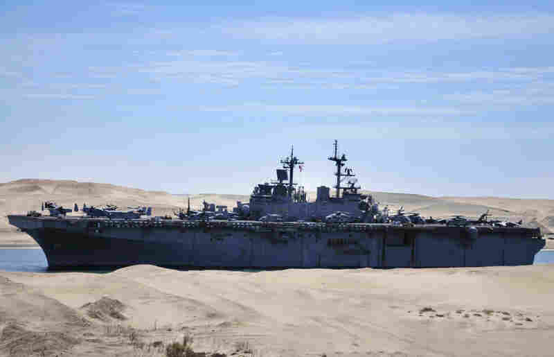 The amphibious assault ship USS Kearsarge traveled through the Suez Canal in Ismailia, Egypt, on Wednesday on its way to the Mediterranean.