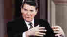 """President Ronald Reagan gestures during a news conference at the White House in January 1986, when he said there was """"irrefutable evidence"""" that Libyan leader Moammar Gadhafi was involved in airport attacks in Rome and Vienna in December 1985."""