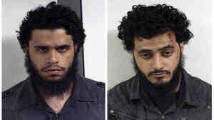 An undated file photo provided by U.S. Marshals shows Carlos Eduardo Almonte, left, and Mohamed Mahmood Alessa, right, who were arrested at New York's Kennedy Airport on June 5, 2010.