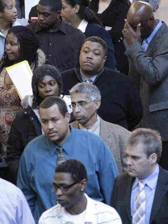 Job seekers line up for a job fair at a hotel in Dallas last month. The unemployment rate can have a psychological effect on people looking for work. If the jobless numbers are high, job seekers may get discouraged.
