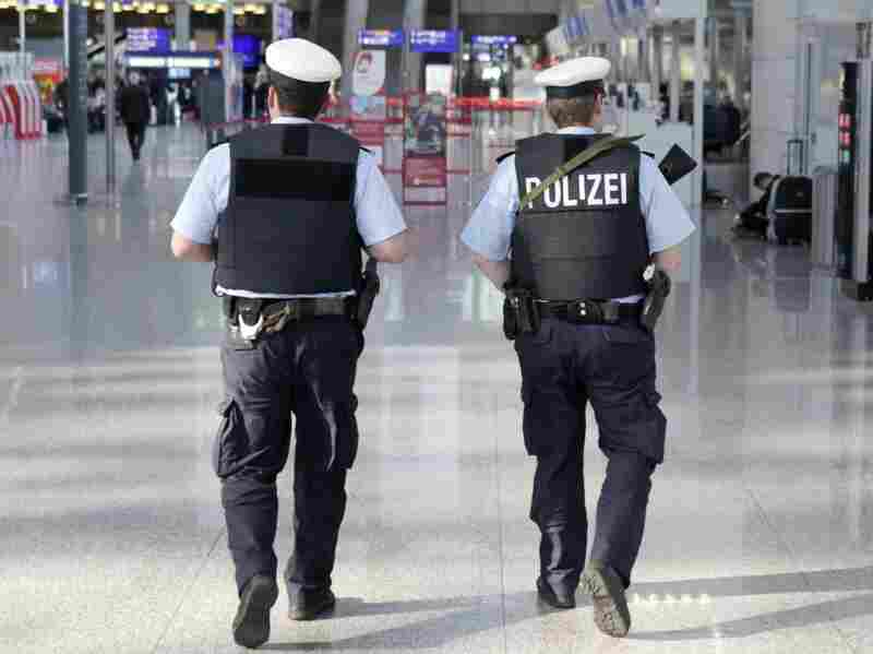 German police patrol the Frankfurt airport a day after Wednesday's attack on a busload of U.S. Air Force personnel that killed two airmen and wounded two others.