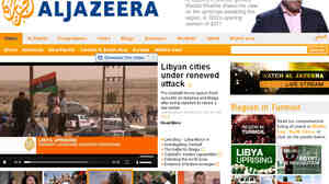 A screenshot shows the Al Jazeera English website. The network has been providing around the clock coverage of unrest in the Middle East.