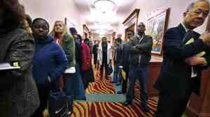 Job seekers line up at a job fair in SeaTac, Wash. The number of people requesting une