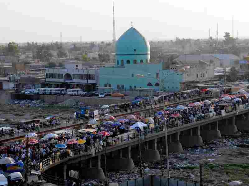 The Khasa bridge in Kirkuk, Iraq, leads from the citadel into the city.  The Khasa bridge is one of the landmarks of the ethnically diverse city of Kirkuk.  It is used as a market and connects the Kurdish-dominated north side to the rest of the city.