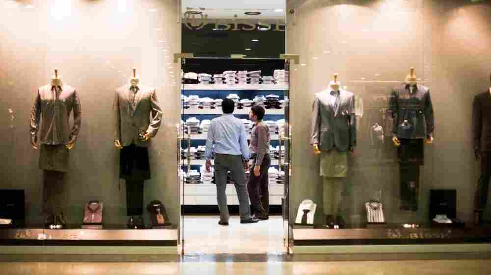 Two men look at shirts at a high-end clothing store in the newly built Majidi Mall in Irbil, Iraq. Irbil, the capital of the semi-autonomous region of Kurdistan, is experiencing an economic boom.
