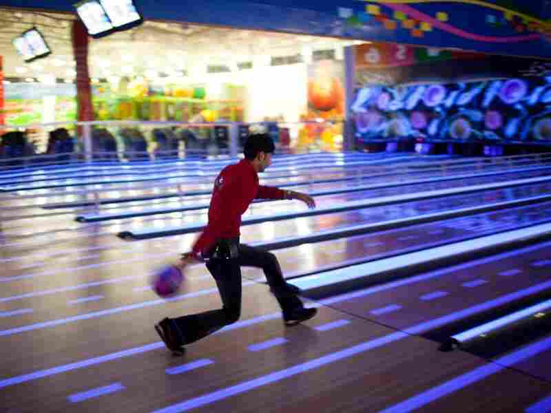 A young man goes bowling on the top floor of the newly built Majidi Mall in Irbil, Iraq.