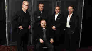 In this Jan. 13, 2011 photo, cast members of the Broadway play That Championship Season, from left, Jim Gaffigan, Chris Noth, Brian Cox, seated, Kiefer Sutherland and Jason Patric pose for a portrait in New York.