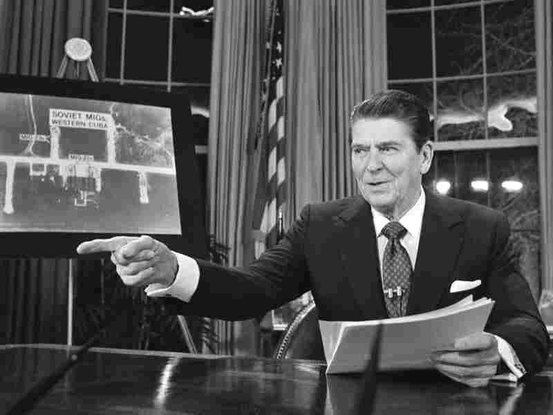 President Reagan addresses the nation on television from Washington in support of his proposed defense budget, March 23, 1983. When he took office, Reagan promised to drastically reduce the size of government but said budget cuts would not hurt the truly needy. It turned out that wasn't completely true — the Reagan budget cut food stamps, welfare and Medicaid.