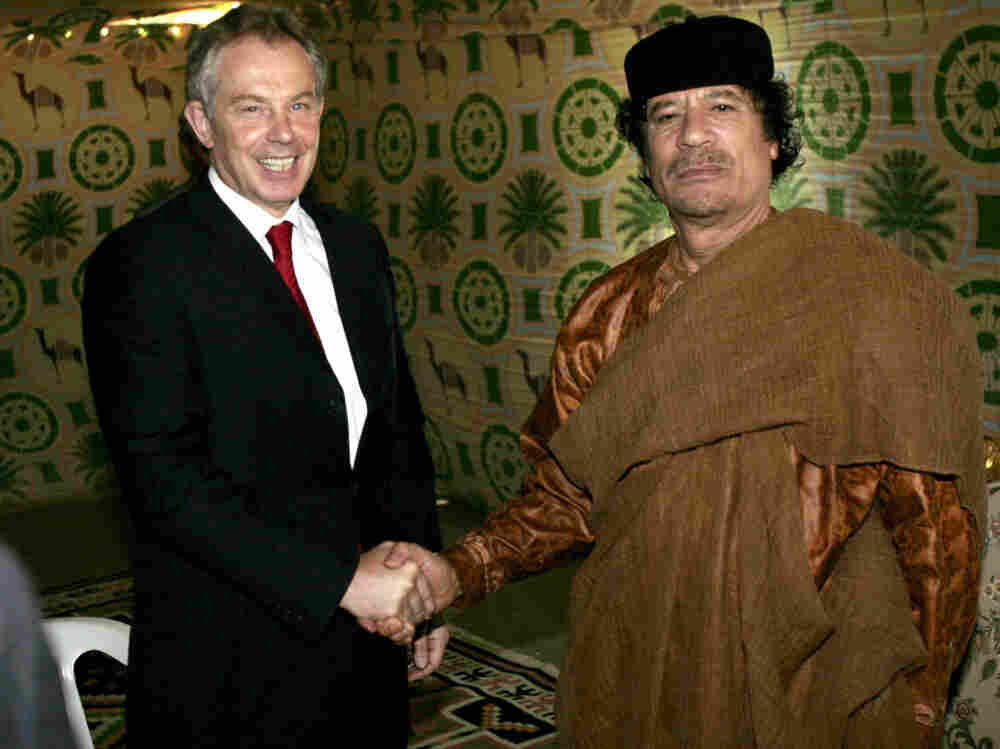 In a switch, Britain's impounding of around $1.5 billion in Libyan cash might have Moammar Gadhafi regretting the thaw between the two nations, brokered by Prime Minister Tony Blair. Here, the two pose at Gadhafi's desert base south of Tripoli in 2007.