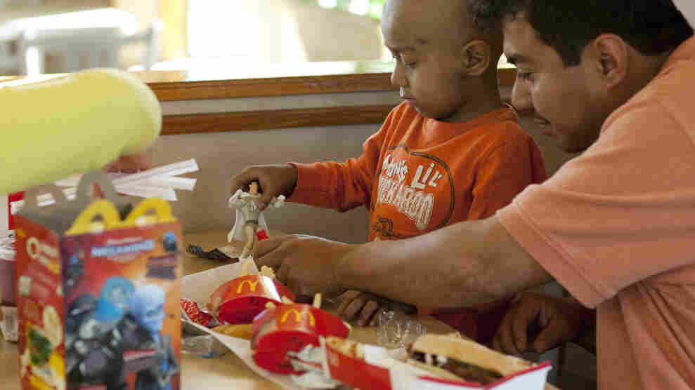 Five-year-old Andy Villatoro plays with a toy he received with a Happy Meal at a San Francisco McDonald's last year.